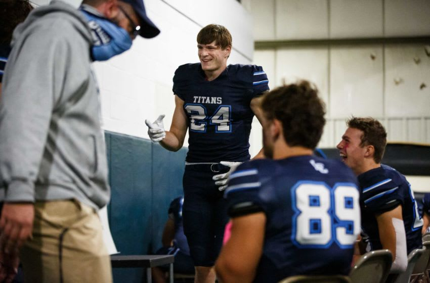 Lewis Central's Thomas Fidone (24) laughs with his teammates during their football game on Friday, Oct. 16, 2020, in Council Bluffs. Lewis Central would go on to beat Creston 63-12. 20201016 009 Fidone Bp Jpg