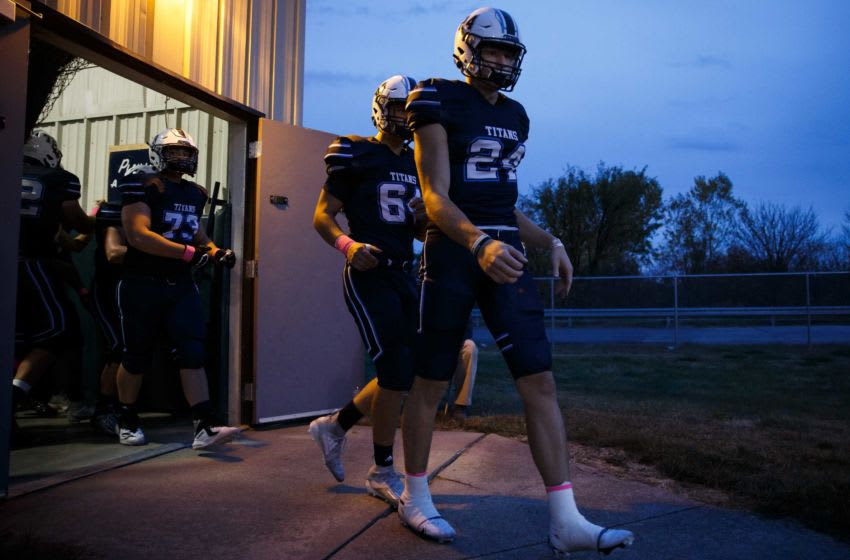 Lewis Central's Thomas Fidone leads the Titans onto the field before their football game against Creston on Friday, Oct. 16, 2020, in Council Bluffs. 20201016 001 Fidone Bp Jpg