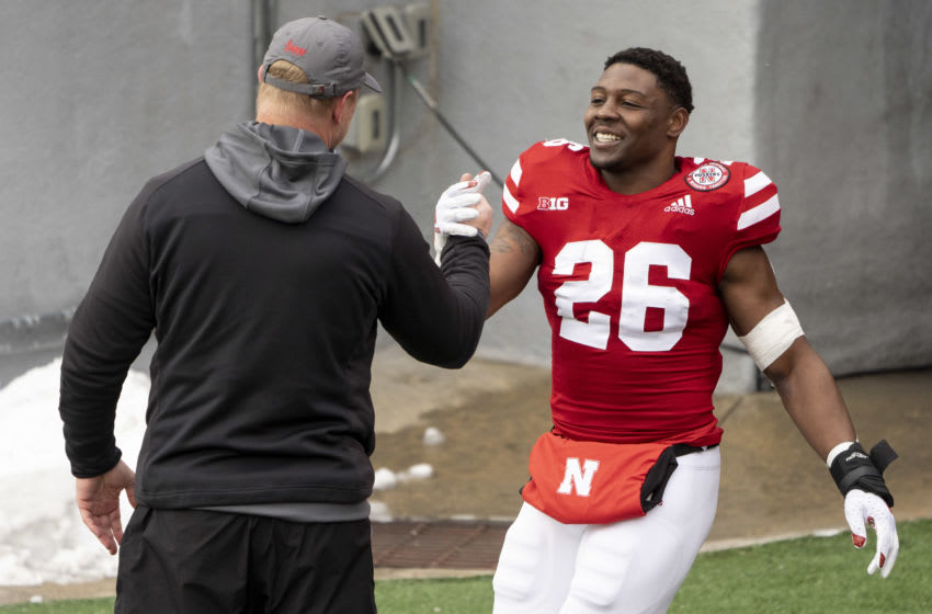 Dec 12, 2020; Lincoln, Nebraska, USA; Nebraska Cornhuskers running back Dedrick Mills (26) shakes hands with coach Scott Frost (left) as seniors are being recognized before a game against the Minnesota Golden Gophers at Memorial Stadium. Mandatory Credit: Dylan Widger-USA TODAY Sports
