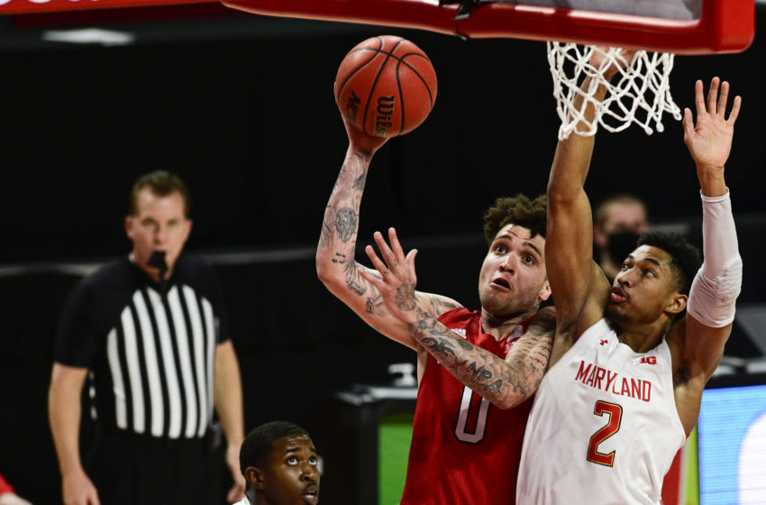 Feb 17, 2021; College Park, Maryland, USA; Nebraska Cornhuskers guard Teddy Allen (0) looks to shoot as Maryland Terrapins guard Aaron Wiggins (2) defends during the first half at Xfinity Center. Mandatory Credit: Tommy Gilligan-USA TODAY Sports