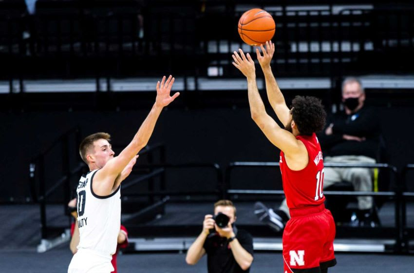 Nebraska guard Kobe Webster makes a 3-point basket as Iowa's Joe Wieskamp, left, defends during a NCAA Big Ten Conference men's basketball game, Thursday, March 4, 2021, at Carver-Hawkeye Arena in Iowa City, Iowa. 210304 Neb Iowa Mbb 011 Jpg