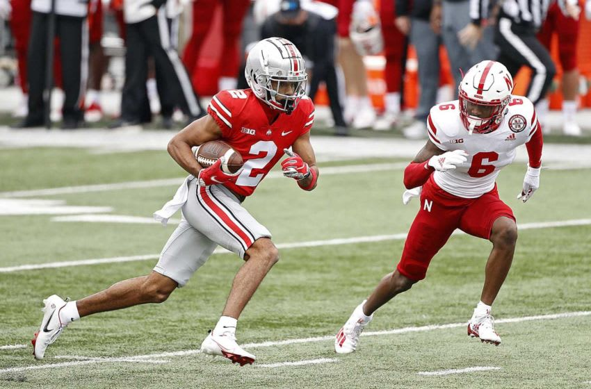 Ohio State Buckeyes wide receiver Chris Olave (2) heads up field after a catch against Nebraska Cornhuskers cornerback Quinton Newsome (6) during the 3rd quarter in their NCAA Division I football game on Saturday, Oct. 24, 2020 at Ohio Stadium in Columbus, Ohio. Osu20neb Kwr 36