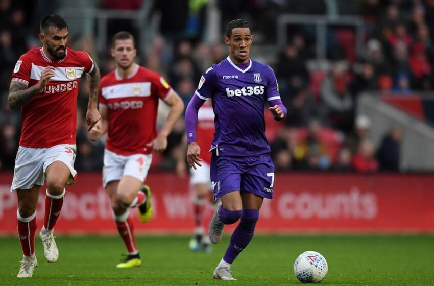 BRISTOL, ENGLAND - OCTOBER 27: Thomas Ince of Stoke City breaks away from Marlon Pack of Bristol City during the Sky Bet Championship match between Bristol City and Stoke City at Ashton Gate on October 27, 2018 in Bristol, England. (Photo by Alex Davidson/Getty Images)