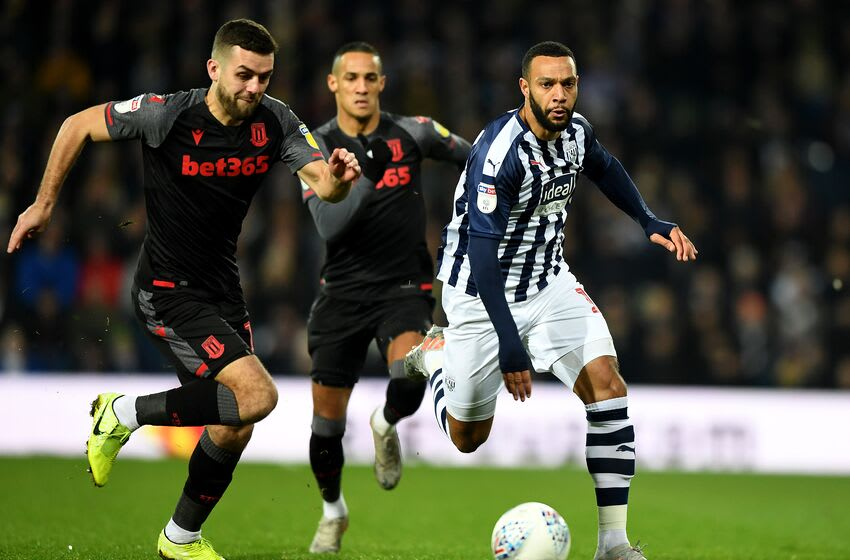 WEST BROMWICH, ENGLAND - JANUARY 20: Matt Philips of West Brom gets past Tommy Smith of Stoke during the Sky Bet Championship match between West Bromwich Albion and Stoke City at The Hawthorns on January 20, 2020 in West Bromwich, England. (Photo by Gareth Copley/Getty Images)