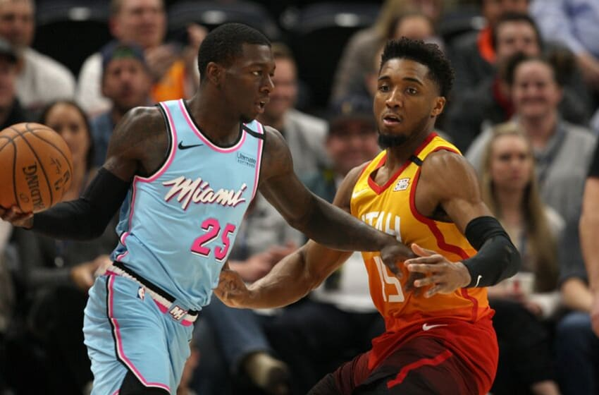 Kendrick Nunn #25 of the Miami Heat controls the ball against Donovan Mitchell (Photo by Chris Gardner/Getty Images)