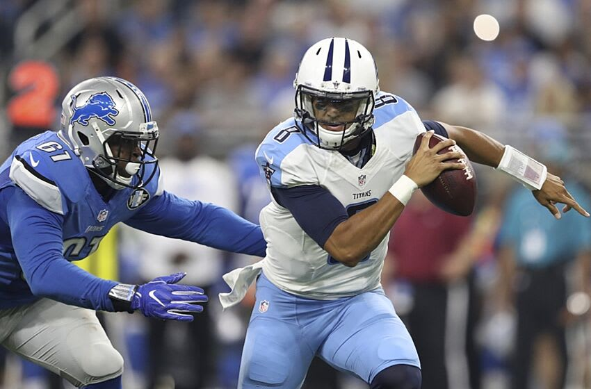 Sep 18, 2016; Detroit, MI, USA; Tennessee Titans quarterback Marcus Mariota (8) gets pursued by Detroit Lions defensive end Kerry Hyder (61) during the first quarter at Ford Field. Mandatory Credit: Raj Mehta-USA TODAY Sports