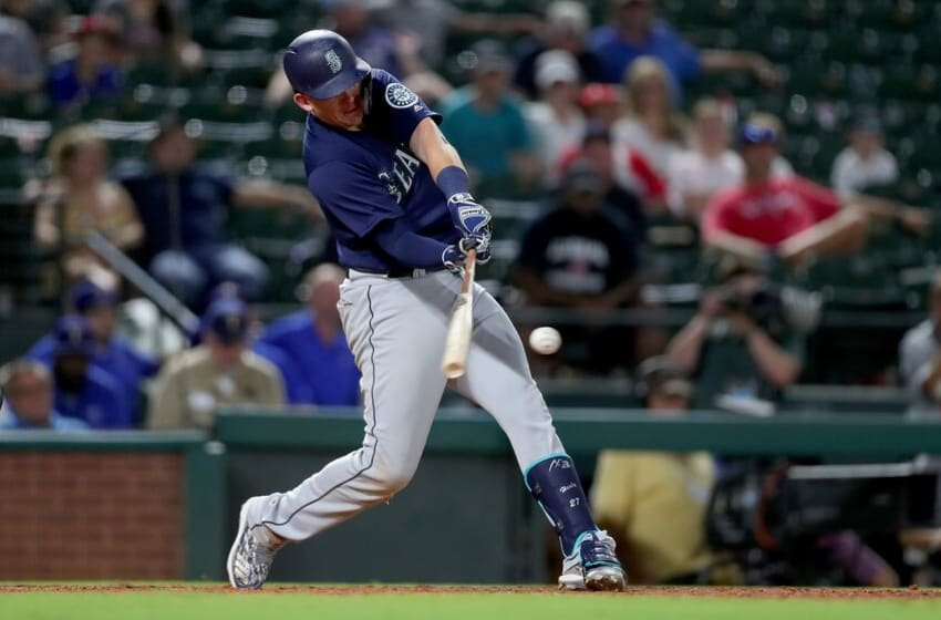 ARLINGTON, TX - AUGUST 06: Ryon Healy #27 of the Seattle Mariners hits an RBI single against the Texas Rangers in the top of the twelfth inning at Globe Life Park in Arlington on August 6, 2018 in Arlington, Texas. (Photo by Tom Pennington/Getty Images)