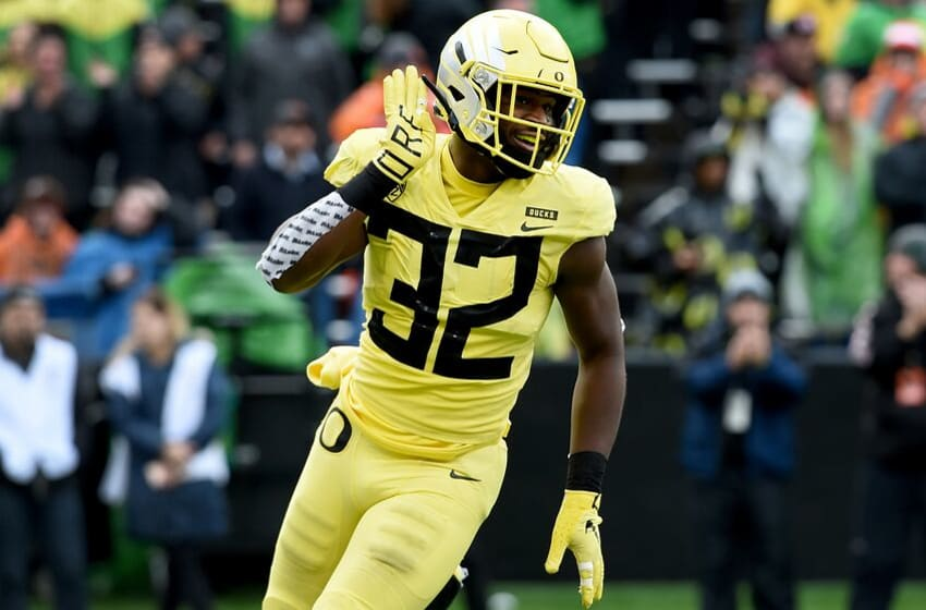 CORVALLIS, OREGON - NOVEMBER 23: Linebacker La'Mar Winston Jr. #32 of the Oregon Ducks celebrates after knocking down a pass during the first half of the game against the Oregon State Beavers at Reser Stadium on November 23, 2018 in Corvallis, Oregon. (Photo by Steve Dykes/Getty Images)