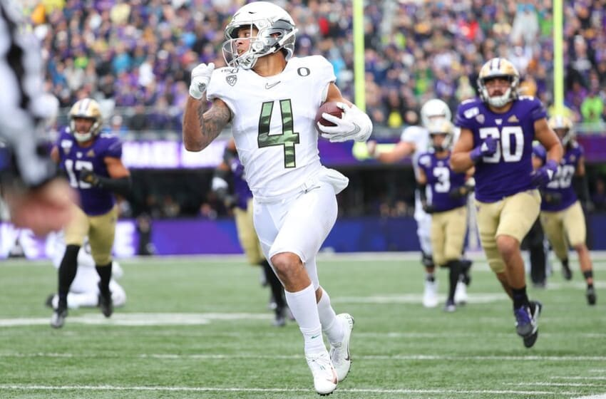 SEATTLE, WASHINGTON - OCTOBER 19: Mycah Pittman #4 of the Oregon Ducks runs for a 36 yard touchdown against the Washington Huskies in the fourth quarter during their game at Husky Stadium on October 19, 2019 in Seattle, Washington. (Photo by Abbie Parr/Getty Images)