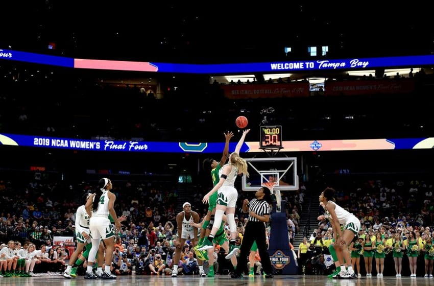 TAMPA, FLORIDA - APRIL 05: Ruthy Hebard #24 of the Oregon Ducks and Lauren Cox #15 of the Baylor Lady Bears battle for the opening tipoff during the first quarter in the semifinals of the 2019 NCAA Women's Final Four at Amalie Arena on April 05, 2019 in Tampa, Florida. (Photo by Mike Ehrmann/Getty Images)