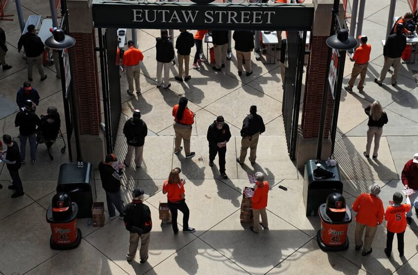 BALTIMORE, MD - MARCH 29: Fans enter the ballpark before the Minnesota Twins play the Baltimore Orioles in their Open Day game at Oriole Park at Camden Yards on March 29, 2018 in Baltimore, Maryland. (Photo by Patrick Smith/Getty Images)