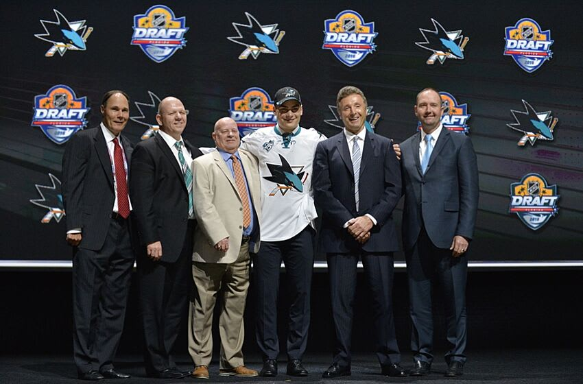 Jun 26, 2015; Sunrise, FL, USA; Timo Meier poses for a photo with team executives after being selected as the number nine overall pick to the San Jose Sharks in the first round of the 2015 NHL Draft at BB&T Center. Mandatory Credit: Steve Mitchell-USA TODAY Sports