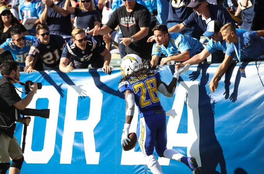 CARSON, CA - NOVEMBER 25: Running back Melvin Gordon #28 of the Los Angeles Chargers celebrates with fans after scoring a touchdown in the second quarter against the Arizona Cardinals at StubHub Center on November 25, 2018 in Carson, California. (Photo by Sean M. Haffey/Getty Images)