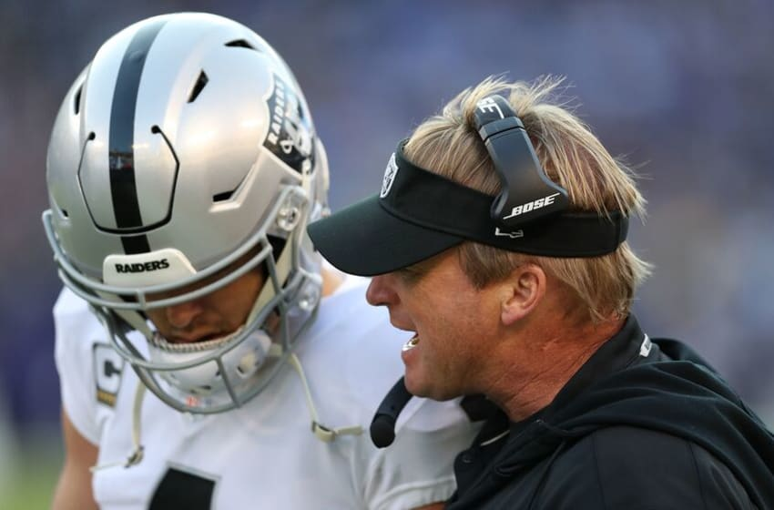 BALTIMORE, MARYLAND - NOVEMBER 25: Head Coach Jon Gruden of the Oakland Raiders talks with quarterback Derek Carr #4 during the fourth quarter against the Baltimore Ravens at M&T Bank Stadium on November 25, 2018 in Baltimore, Maryland. (Photo by Rob Carr/Getty Images)
