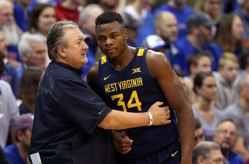 LAWRENCE, KANSAS - JANUARY 04: Head coach Bob Huggins of the West Virginia Mountaineers talks with Oscar Tshiebwe #34 during the game against the Kansas Jayhawks at Allen Fieldhouse on January 04, 2020 in Lawrence, Kansas. (Photo by Jamie Squire/Getty Images)