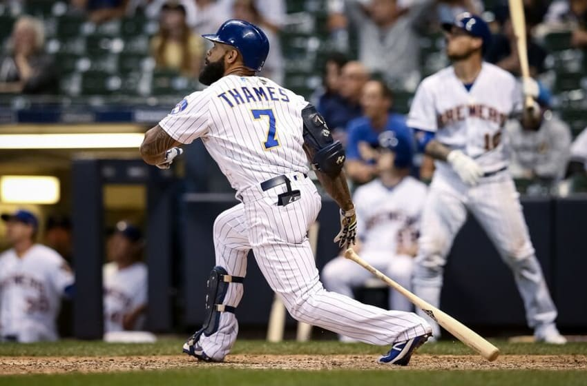 MILWAUKEE, WISCONSIN - AUGUST 09: Eric Thames #7 of the Milwaukee Brewers hits a home run in the ninth inning to beat the Texas Rangers 6-5 at Miller Park on August 09, 2019 in Milwaukee, Wisconsin. (Photo by Dylan Buell/Getty Images)
