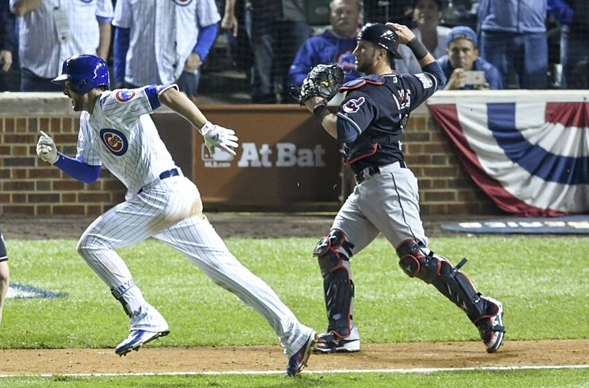 Oct 28, 2016; Chicago, IL, USA; Cleveland Indians catcher Yan Gomes (right) throws out Chicago Cubs third baseman Kris Bryant (left) after Bryant struck out swinging during the eighth inning in game three of the 2016 World Series at Wrigley Field. Mandatory Credit: Jerry Lai-USA TODAY Sports