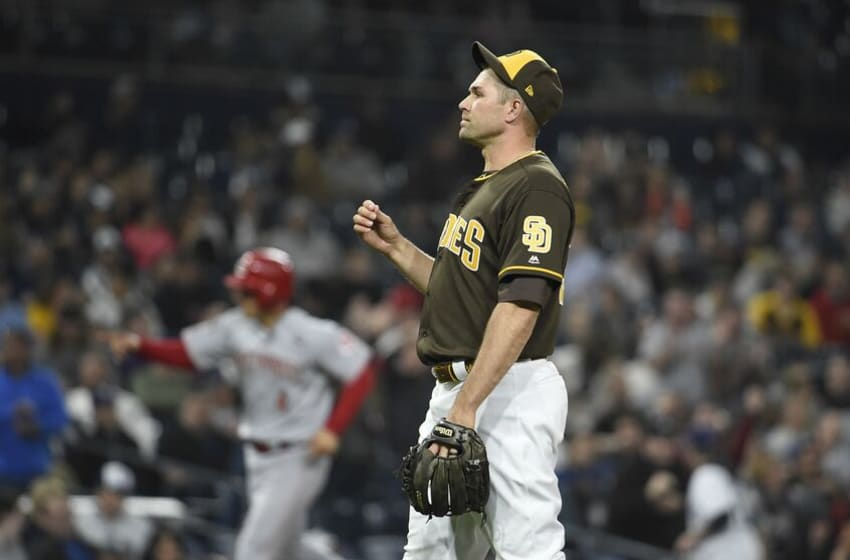 SAN DIEGO, CA - APRIL 19: Craig Stammen #34 of the San Diego Padres stands on the mound after giving up a two-run home run to Derek Dietrich #22 of the Cincinnati Reds during the eleventh inning of a baseball game at Petco Park April 19, 2019 in San Diego, California. (Photo by Denis Poroy/Getty Images)