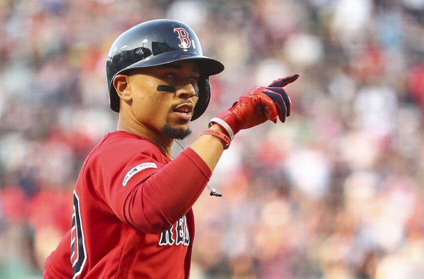 BOSTON, MA - JULY 26: Mookie Betts #50 of the Boston Red Sox reacts as he crosses home plate after hitting a solo home run in the first inning of a game against the New York Yankees at Fenway Park on July 26, 2019 in Boston, Massachusetts. (Photo by Adam Glanzman/Getty Images)