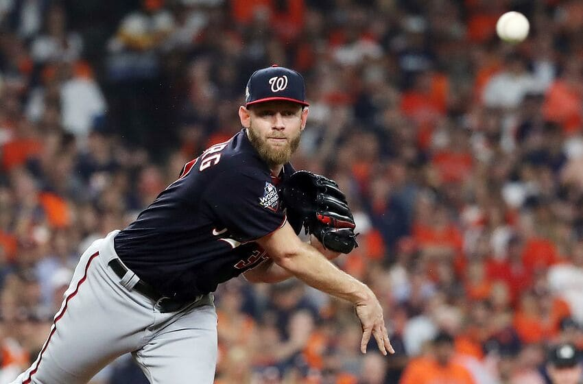 HOUSTON, TEXAS - OCTOBER 23: Stephen Strasburg #37 of the Washington Nationals attempts a pickoff against the Houston Astros during the third inning in Game Two of the 2019 World Series at Minute Maid Park on October 23, 2019 in Houston, Texas. (Photo by Elsa/Getty Images)