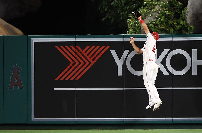 ANAHEIM, CALIFORNIA - APRIL 08: Mike Trout #27 of the Los Angeles Angels catches a fly ball hit by Christian Yelich #22 of the Milwaukee Brewers during the second inning of a game at Angel Stadium of Anaheim on April 08, 2019 in Anaheim, California. (Photo by Sean M. Haffey/Getty Images)