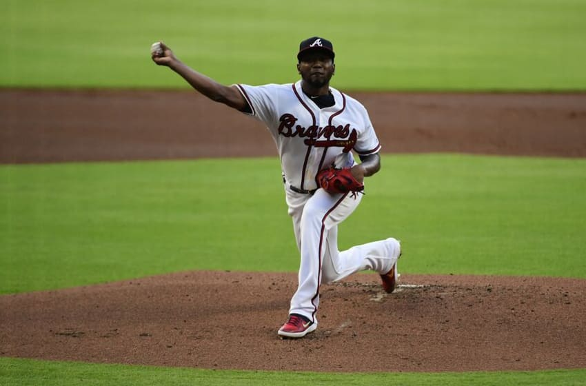 ATLANTA, GEORGIA - AUGUST 21: Julio Teheran #49 of the Atlanta Braves pitches in the third inning against the Miami Marlins at SunTrust Park on August 21, 2019 in Atlanta, Georgia. (Photo by Logan Riely/Getty Images)