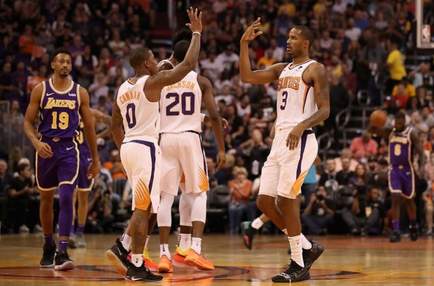 PHOENIX, AZ - OCTOBER 24: Trevor Ariza #3 of the Phoenix Suns high fives Isaiah Canaan #0 after scoring against the Los Angeles Lakers during the first half of the NBA game at Talking Stick Resort Arena on October 24, 2018 in Phoenix, Arizona. NOTE TO USER: User expressly acknowledges and agrees that, by downloading and or using this photograph, User is consenting to the terms and conditions of the Getty Images License Agreement. (Photo by Christian Petersen/Getty Images)