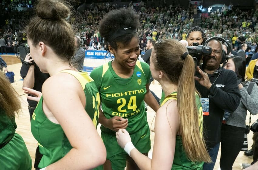 PORTLAND, OR - MARCH 31: Oregon Ducks forward Ruthy Hebard (24) reacts with Oregon Ducks guard Sabrina Ionescu (20) during the NCAA Division I Women's Championship Elite Eight round basketball game between the Oregon Ducks and Mississippi State Bulldogs on March 31, 2019 at Moda Center in Portland, Oregon. (Photo by Joseph Weiser/Icon Sportswire via Getty Images)