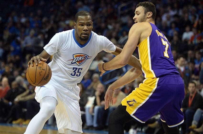 Dec 19, 2015; Oklahoma City, OK, USA; Oklahoma City Thunder forward Kevin Durant (35) drives to the basket against Los Angeles Lakers forward Larry Nance Jr. (7) during the third quarter at Chesapeake Energy Arena. Mandatory Credit: Mark D. Smith-USA TODAY Sports