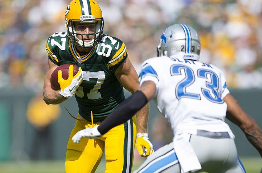 Sep 25, 2016; Green Bay, WI, USA; Green Bay Packers wide receiver Jordy Nelson (87) rushes with the football after catching a pass as Detroit Lions cornerback Darius Slay (23) defends during the second quarter at Lambeau Field. Mandatory Credit: Jeff Hanisch-USA TODAY Sports