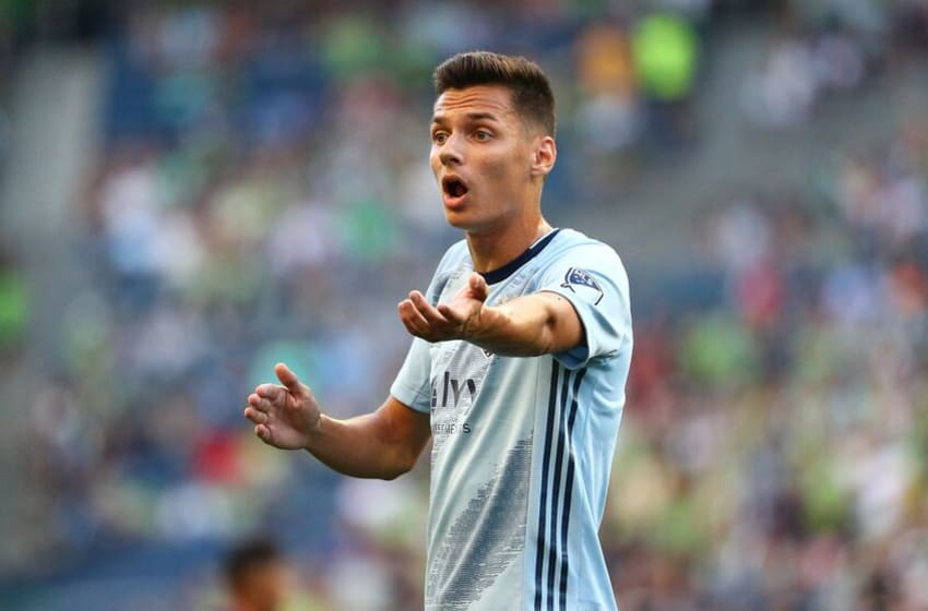 SEATTLE, WASHINGTON - AUGUST 04: Daniel Salloi #20 of Sporting Kansas City reacts against the Seattle Sounders in the first half during their game at CenturyLink Field on August 04, 2019 in Seattle, Washington. (Photo by Abbie Parr/Getty Images)