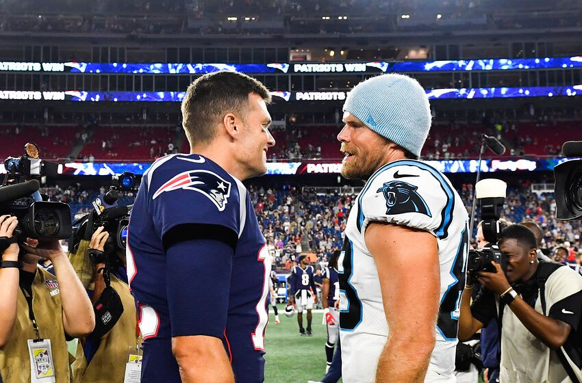 FOXBOROUGH, MA - AUGUST 22: Tom Brady #12 of the New England Patriots meets with Greg Olsen #88 of the Carolina Panthers following the Patriots 10-3 preseason victory at Gillette Stadium on August 22, 2019 in Foxborough, Massachusetts. (Photo by Kathryn Riley/Getty Images)
