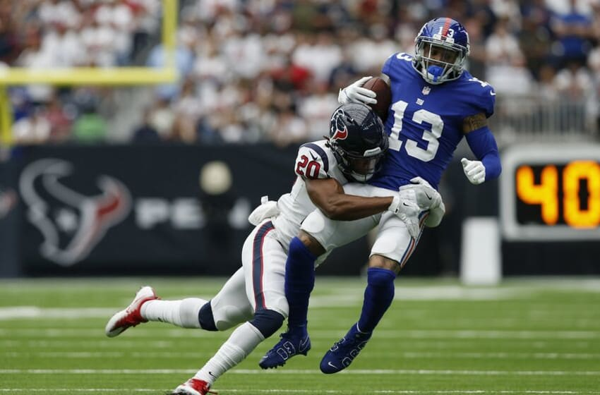 HOUSTON, TX - SEPTEMBER 23: Odell Beckham #13 of the New York Giants is tackled by Justin Reid #20 of the Houston Texans in the second quarter at NRG Stadium on September 23, 2018 in Houston, Texas. (Photo by Tim Warner/Getty Images)