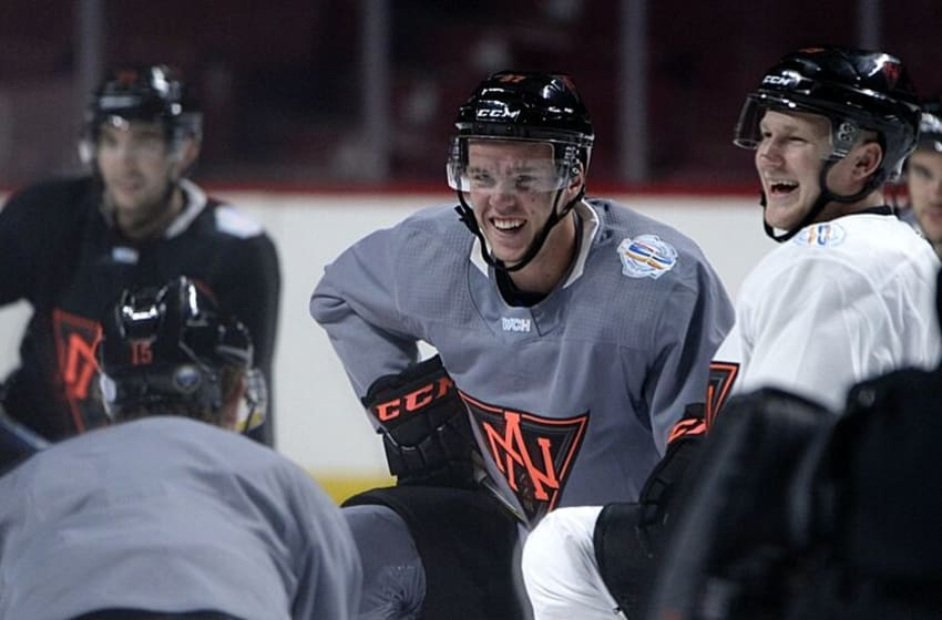 Sep 7, 2016; Montreal, Quebec, Canada; Team North America forward Connor McDavid (97) and teammate Nathan MacKinnon (29) share a laugh during practice for the World Cup of Hockey at Bell Centre. Mandatory Credit: Eric Bolte-USA TODAY Sports