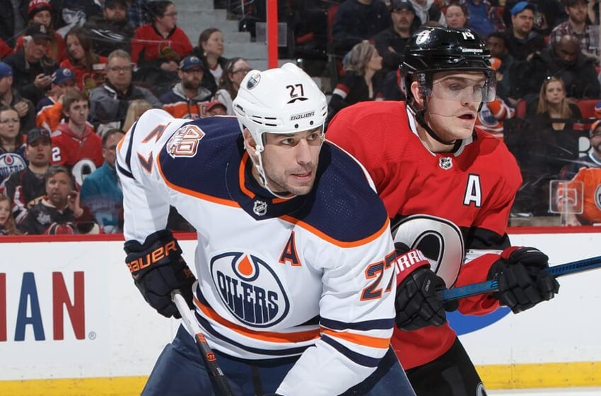 OTTAWA, ON - FEBRUARY 28: Mark Borowiecki #74 of the Ottawa Senators defends against Milan Lucic #27 of the Edmonton Oilers at Canadian Tire Centre on February 28, 2019 in Ottawa, Ontario, Canada. (Photo by Andre Ringuette/NHLI via Getty Images)