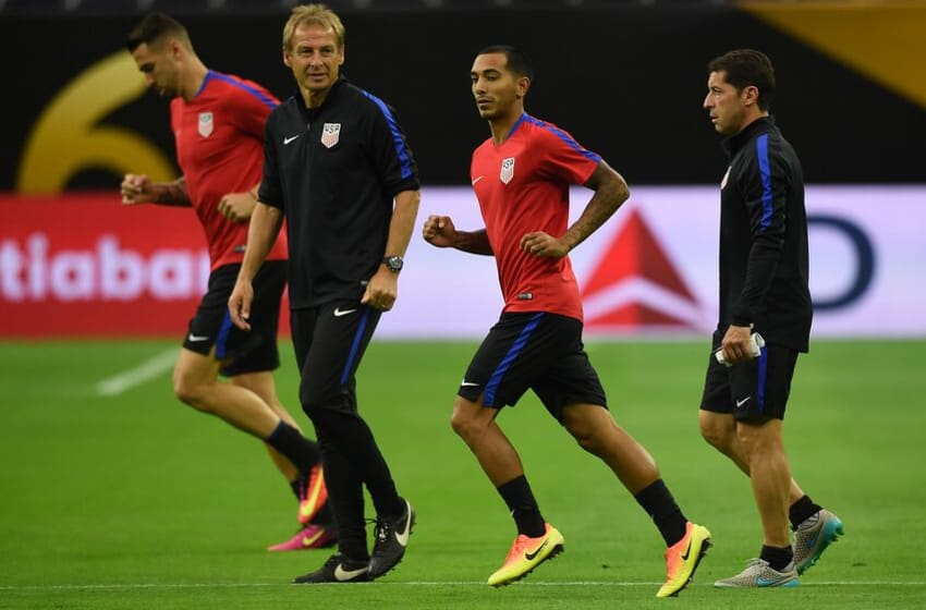 US coach Jurgen Klinsmann (2nd L) with members of the US team as they train on the eve of their COPA America 2016 semi-final soccer match against Argentina at the NRG Stadium in Houston, Texas on June 20, 2016. / AFP / Mark Ralston (Photo credit should read MARK RALSTON/AFP/Getty Images)