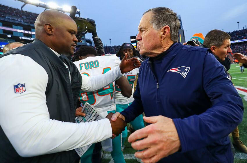 FOXBOROUGH, MA - DECEMBER 29: Head coach Brian Flores of the Miami Dolphins shakes hands with head coach Bill Belichick of the New England Patriots after a Dolphins victory at Gillette Stadium on December 29, 2019 in Foxborough, Massachusetts. (Photo by Adam Glanzman/Getty Images)