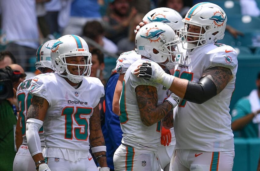 MIAMI, FL - SEPTEMBER 09: (L-R) Albert Wilson #15, Daniel Kilgore #67, and Kenny Stills #10 of the Miami Dolphins celebrate the touchdown in the second quarter against the Tennessee Titans at Hard Rock Stadium on September 9, 2018 in Miami, Florida. (Photo by Mark Brown/Getty Images)