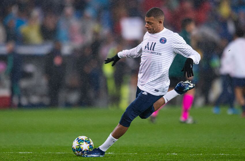 MADRID, SPAIN - NOVEMBER 26: Kylian Mbappe of Paris Saint-Germain warms up prior to the UEFA Champions League group A match between Real Madrid and Paris Saint-Germain at Bernabeu on November 26, 2019 in Madrid, Spain. (Photo by TF-Images/Getty Images)