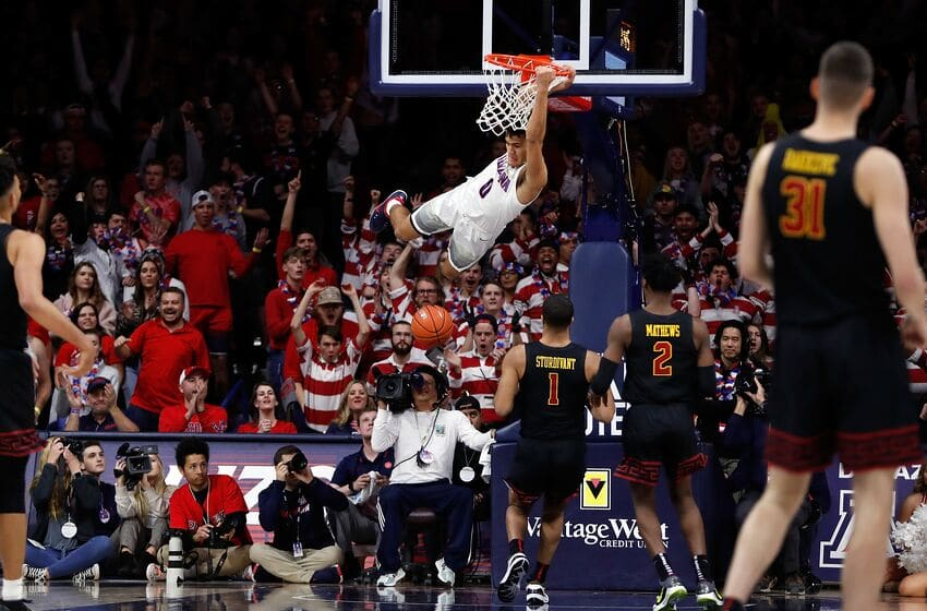 TUCSON, AZ - FEBRUARY 06: Arizona Wildcats guard Josh Green (0) dunks over USC Trojans guard Kyle Sturdivant (1) and guard Jonah Mathews (2) during the first half of the college basketball game at McKale Center on February 6, 2020 in Tucson, Arizona. (Photo by Chris Coduto/Icon Sportswire via Getty Images)