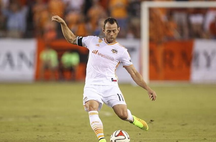 Jul 26, 2014; Houston, TX, USA; Houston Dynamo midfielder Brad Davis (11) kicks the ball during the first half against Aston Villa at BBVA Compass Stadium. Mandatory Credit: Troy Taormina-USA TODAY Sports