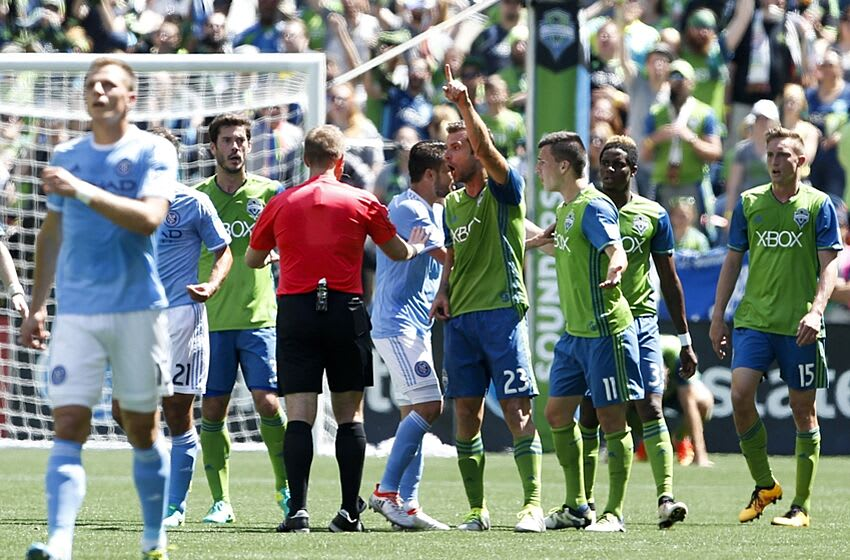 Jun 25, 2016; Seattle, WA, USA; Seattle Sounders FC midfielder Andreas Ivanschitz (23) argues with referee Alan Kelly after an apparent hand ball by New York City FC midfielder Frank Lampard (8) which resulted in a goal during the first half at CenturyLink Field. New York won 2-0. Mandatory Credit: Jennifer Buchanan-USA TODAY Sports