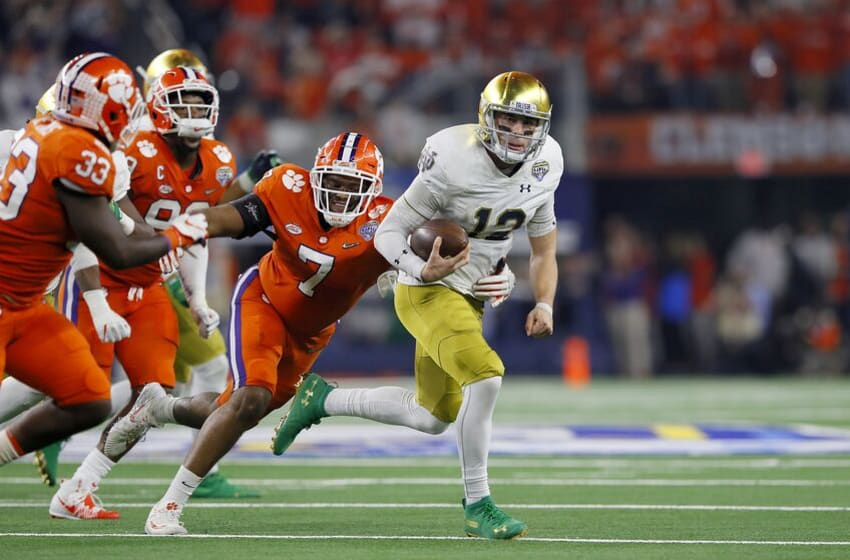 ARLINGTON, TEXAS - DECEMBER 29: Ian Book #12 of the Notre Dame Fighting Irish runs with the ball against Austin Bryant #7 of the Clemson Tigers in the second half during the College Football Playoff Semifinal Goodyear Cotton Bowl Classic at AT&T Stadium on December 29, 2018 in Arlington, Texas. (Photo by Kevin C. Cox/Getty Images)