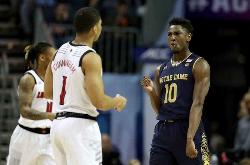 CHARLOTTE, NORTH CAROLINA - MARCH 13: TJ Gibbs #10 of the Notre Dame Fighting Irish reacts after a play against the Louisville Cardinals during their game in the second round of the 2019 Men's ACC Basketball Tournament at Spectrum Center on March 13, 2019 in Charlotte, North Carolina. (Photo by Streeter Lecka/Getty Images)