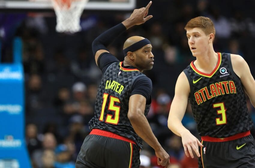CHARLOTTE, NORTH CAROLINA - DECEMBER 08: Vince Carter #15 reacts after a basket alongside teammate Kevin Huerter #3 of the Atlanta Hawks during their game against the Charlotte Hornets at Spectrum Center on December 08, 2019 in Charlotte, North Carolina. NOTE TO USER: User expressly acknowledges and agrees that, by downloading and or using this photograph, User is consenting to the terms and conditions of the Getty Images License Agreement. (Photo by Streeter Lecka/Getty Images)