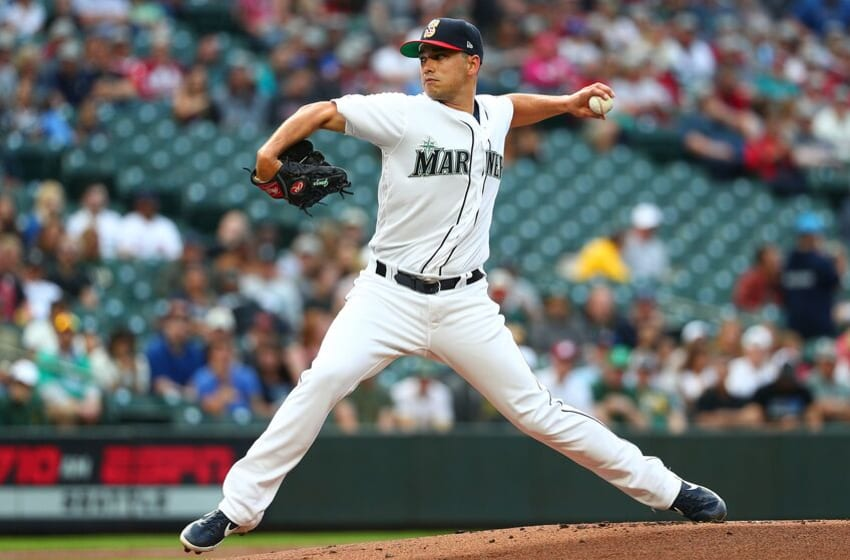 SEATTLE, WASHINGTON - JULY 06: Marco Gonzales #7 of the Seattle Mariners pitches against the Oakland Athletics in the first inning during their game at T-Mobile Park on July 06, 2019 in Seattle, Washington. (Photo by Abbie Parr/Getty Images)