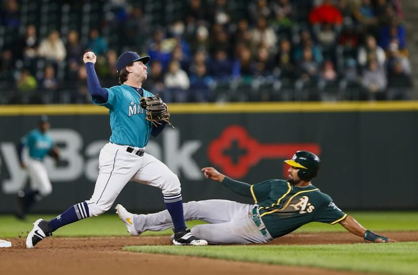 SEATTLE, WA - SEPTEMBER 27: Donnie Walton #31 of the Seattle Mariners tags Marcus Semien #10 of the Oakland Athletics out at second base in the fifth inning at T-Mobile Park on September 27, 2019 in Seattle, Washington. (Photo by Lindsey Wasson/Getty Images)