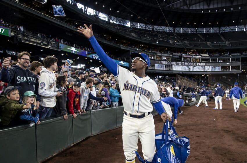 SEATTLE, WA - SEPTEMBER 29: Shed Long #39 of the Seattle Mariners hands out memorbilia after a game against the Oakland Athletics to end the season at T-Mobile Park on September 29, 2019 in Seattle, Washington. The Mariners won 3-1. (Photo by Stephen Brashear/Getty Images)
