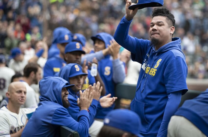SEATTLE, WA - SEPTEMBER 29: Felix Hernandez #34 of the Seattle Mariners acknowledges fans from the dugout after a video was show feature the pitcher during the fourth inning of a game against the Oakland Athletics at T-Mobile Park on September 29, 2019 in Seattle, Washington. (Photo by Stephen Brashear/Getty Images)