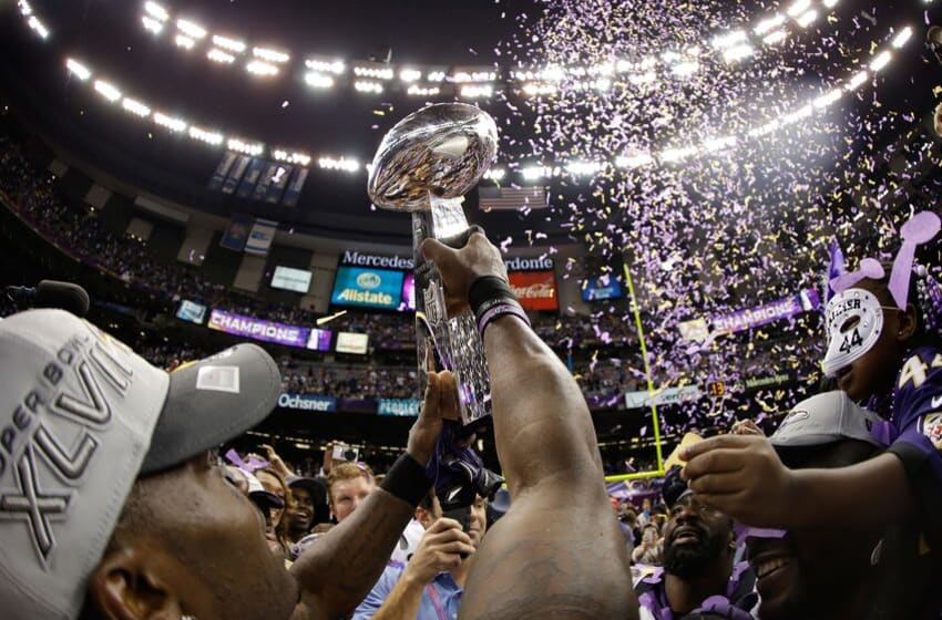 NEW ORLEANS, LA - FEBRUARY 03: The Baltimore Ravens celebrate with the Vince Lombardi Championship trophy celebrate after the Ravens won 34-31 against the San Francisco 49ers during Super Bowl XLVII at the Mercedes-Benz Superdome on February 3, 2013 in New Orleans, Louisiana. (Photo by Ezra Shaw/Getty Images)